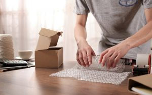 A Class Movers will offer services that include packing up your belongings for you.