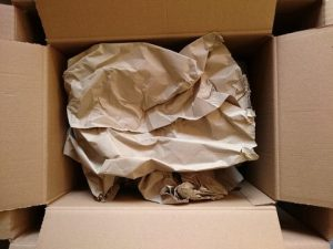 Crumpled paper is simple and effective packing material for filling the gaps in the boxes while shipping.